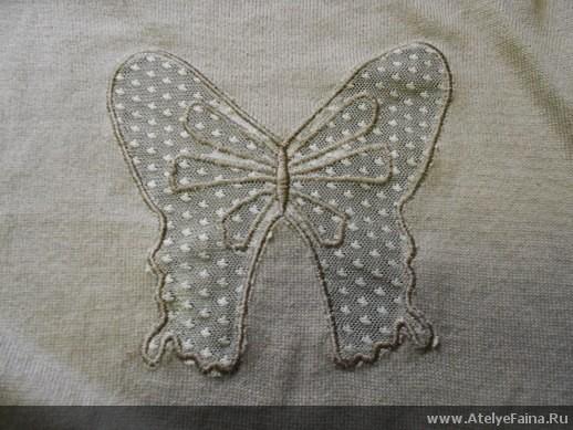бабочка на спине кардигана